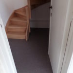 Linoleumvloer, binnendeur naar trap